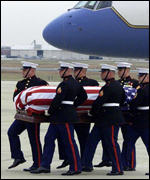 The remains of US combat casualty Johnny Mike Spann arrive in America