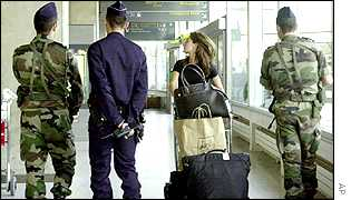 French police and soldiers at Charles de Gaulles airport