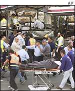 Rescuers at the scene of the Haifa bus bombing