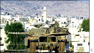 an Israeli tank watches over Jenin