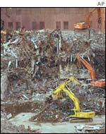 Diggers in rubble