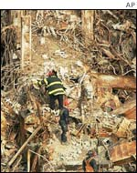 Firefighters on rubble