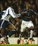 Ledley King (left) is unable to stop Rod Wallace scoring Bolton's second
