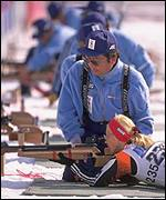 A Biathlon competitor takes aim in the shooting discipline of the event