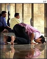 Indonesian Muslim praying in a mosque