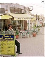 Owner of the cafe in the Turkish part of Nicosia waits for clients