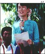 Aung San Suu Kyi addresses supporters outside her house