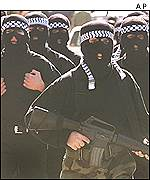Masked Fatah activists march in Ramallah, January 2001