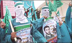 Masked Hamas men demonstrate against the killing of leader Mahmoud Abu Hanoud
