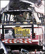 The wreckage of a bus destroyed by a suicide bomber