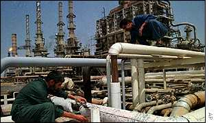 Oil workers at refinery