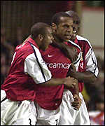 Thierry Henry is congratulated by Lauren