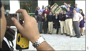 Enron staff pose for photographs