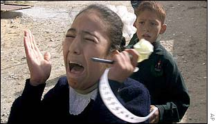A Palestinian school girl screams and cries in shock during an Israeli attack on Gaza City