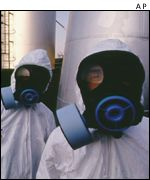 Workers in protective suits