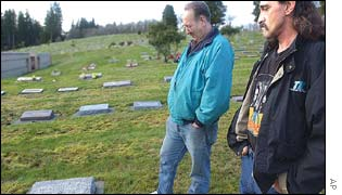 Victim Carol Christensen's brother-in-law Bob Christensen and her brother Don Holmin at her grave in Washington state
