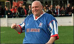 Buster Bloodvessel gees up the Margate fans before a match