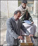 Man playing the accordion at Kabul University