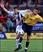 Thompson gets to grips with Larsson