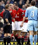 Manchester United midfielder Roy Keane confronts referee Paul Durkin
