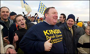 Canvey manager Jeff King is mobbed by Canvey Island supporters