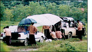 Aung San Suu Kyi locked in her car at a military roadblock September 2000
