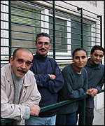 Staff and clients at the offices of the Mouvement de l'immigration et des Banlieues