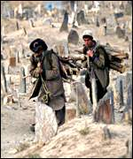 Kabul residents in a local graveyard