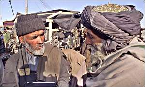 Kabul residents listen to the radio