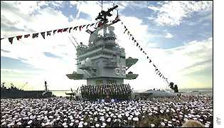 President Bush gives a speech under the island aboard the aircraft carrier USS Enterprise