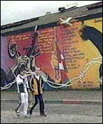 [ image: A Belfast mural spells out the messages of both movements]