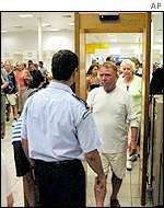 Passenger passing through metal detector