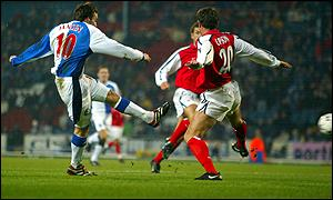 Matt Jansen curls the ball round Matthew Upson for Blackburn's first goal