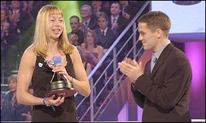 16-year-old Amy Spencer receives her award from Michael Owen