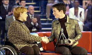 Last year's winner Tanni Grey-Thompson presents Ellen MacArthur with the Helen Rollason award