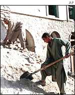 Afghans clear rubble
