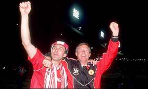 Bryan Robson and Alex Ferguson celebrate winning the FA Cup at Wembley after a 1-0 win over Crystal Palace in 1990