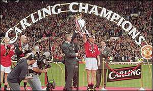 Alex Ferguson celebrates his seventh league title with Roy Keane at Old Trafford