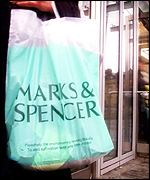 M&S shopping bag outside a store