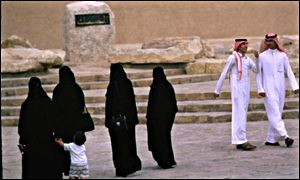 Saudi women in traditional Muslim robes, the abaya