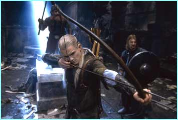 Legolas with Gimli and Boromir prepare to fight the orcs in the tomb