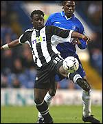 Olivier Bernard (left) tries to hold off Chelsea's Mario Melchiot