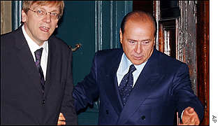 Belgian Prime Minister Guy Verhofstadt (left) and his Italian counterpart Silvio Berlusconi