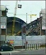 Cardiff's Empire Pool being demolished to make way for the Millennium Stadium.
