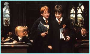 Harry in class, with Ron and Draco