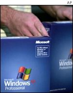 Copies of Microsoft's XP are prepared in the factory