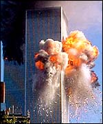 A fireball explodes from one of the World Trade Center towers