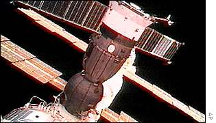 Soyuz spacecraft docked with ISS, AP