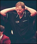 Raymond Barneveld shows his disappointment at losing the 1995 Embassy World  Championship