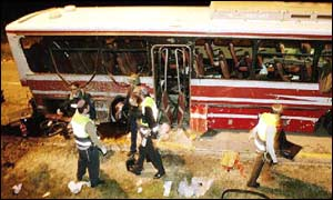 Emergency workers examining the area of the bus that came under attack